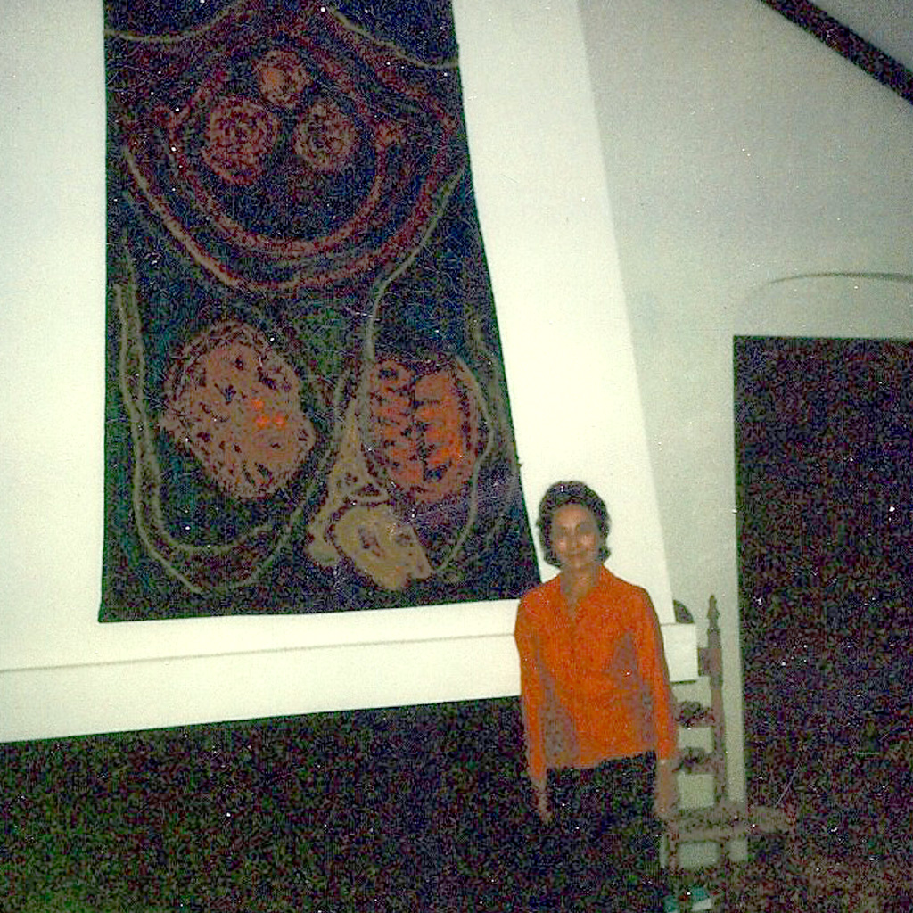 1970s Daphne by the fireplace with commissioned wall art