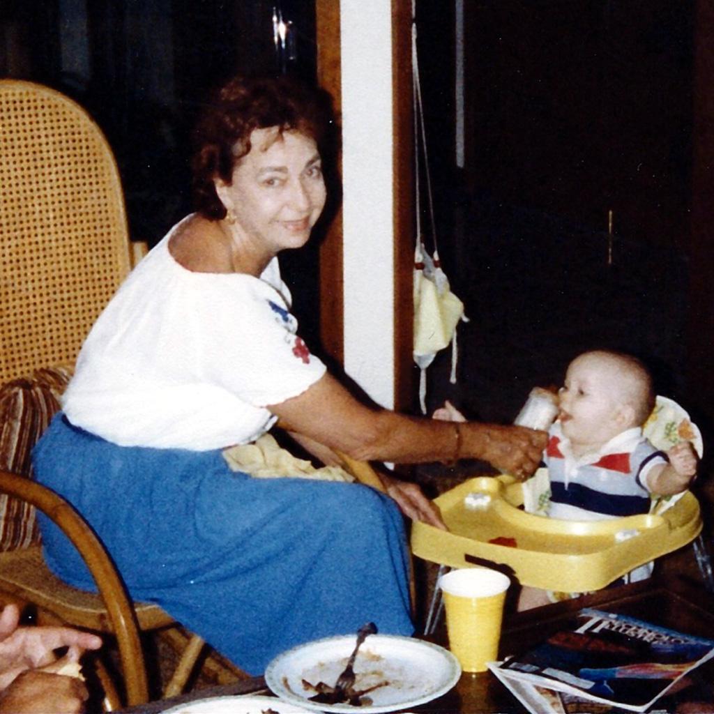 July 1983 Daphne feeding Brandon